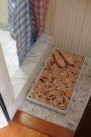 Банный коврик из винных пробок